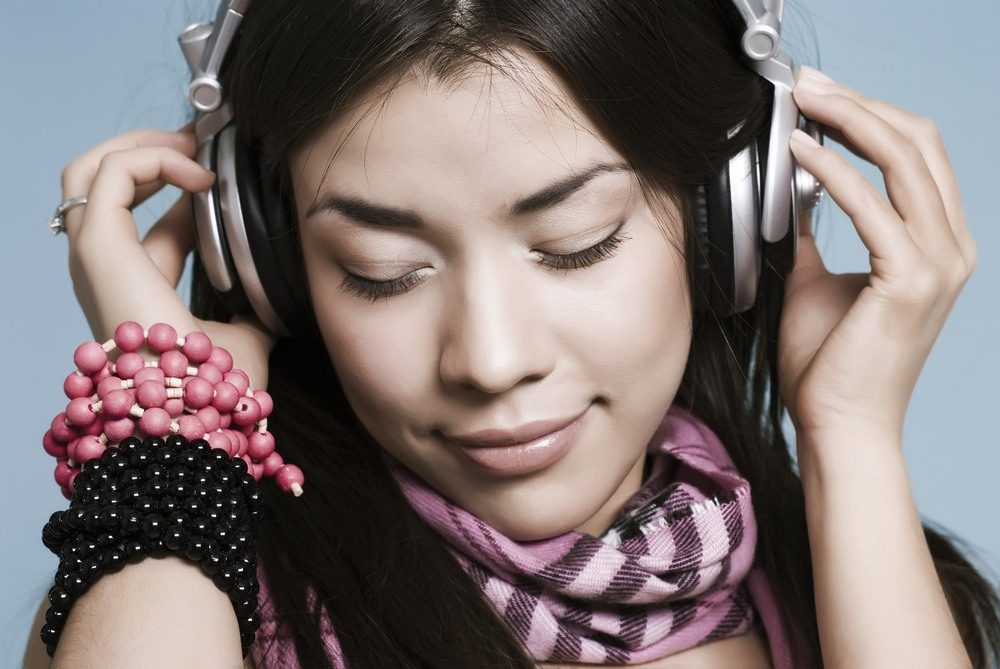 photo of person listening to music on headphones
