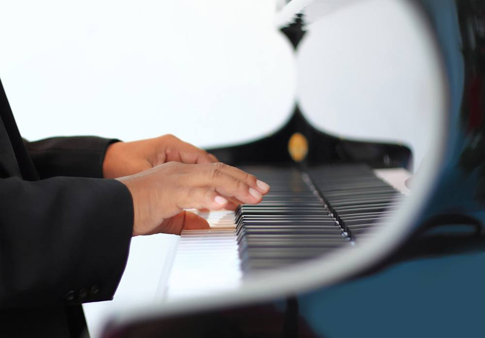 pianist's hands at the keyboard