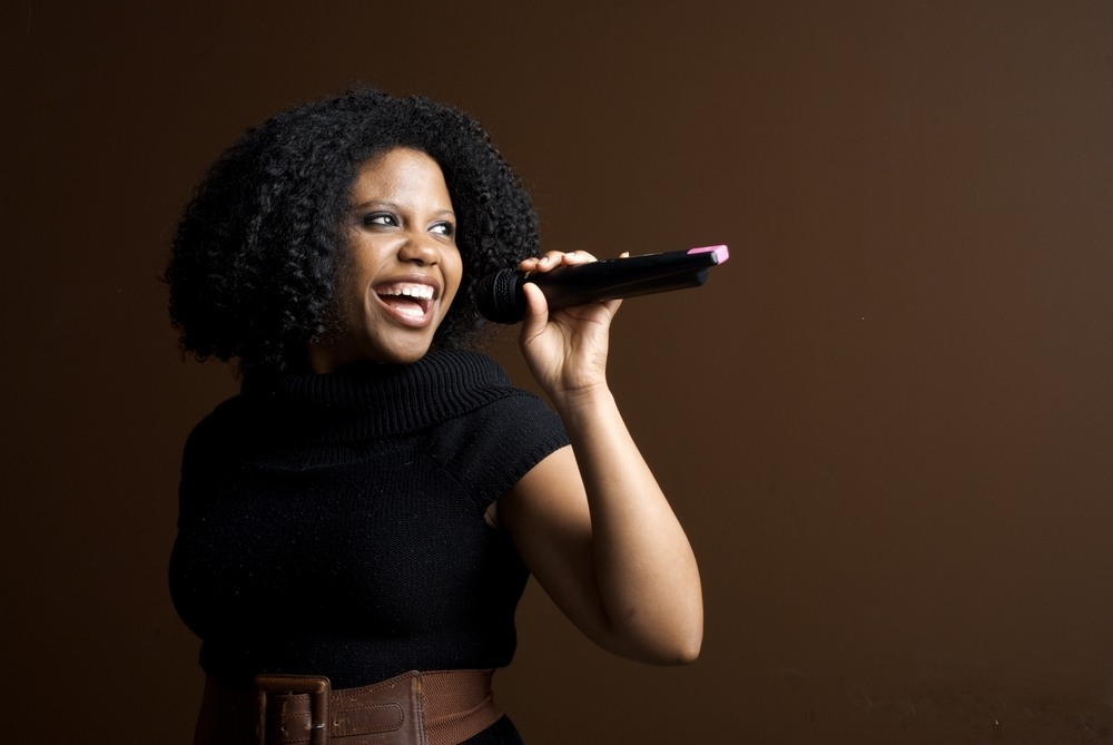 Photo of woman singing confidently
